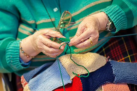 women   s clothes: grandmother knits up the wool