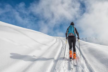 mountaineering: A girl makes ski mountaineering
