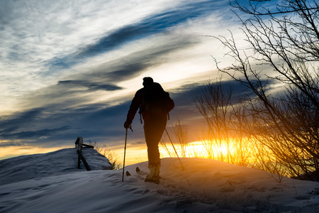 mountaineering: Ski mountaineering silhouette Stock Photo