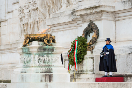 women s health: ROME, ITALY-March 24.2015: a female soldier guard at the monument of the Unknown Soldier at the altar of the fatherland in Rome