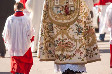 altar boy and priest during a religious ceremony Archivio Fotografico