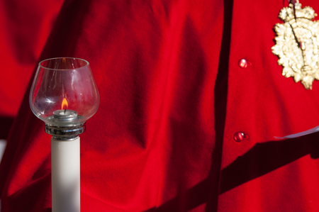 candelabrum: Particular of a candelabrum in front of a red coat
