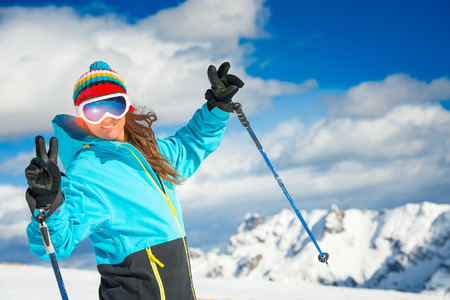 off track: Girl skier smiles before an off track Stock Photo