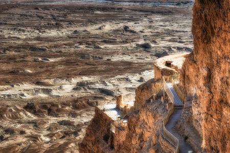 Ruins of Masada with the desert of depression of the Dead Sea in the background photo
