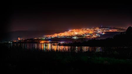galilee: Tiberias at night from the Sea of Galilee