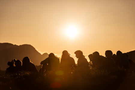 a boy: Group of Boy Scouts at sunset in the mountains