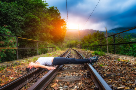 psychic: Girl lying on train tracks