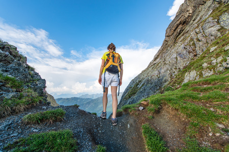 exceeds: Girl Alone Exceeds mountain pass Stock Photo