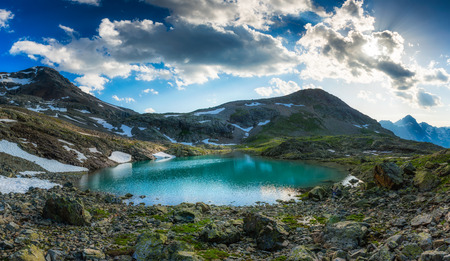laurel mountain: Alpine lake with last snow in summer