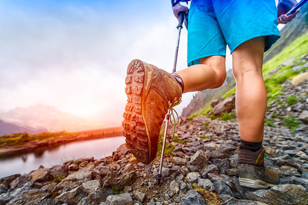 Hiking boot closeup on Mountain trail 写真素材