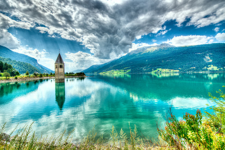 Bell tower of the Reschensee (Resia) South Tyrol Italy Фото со стока