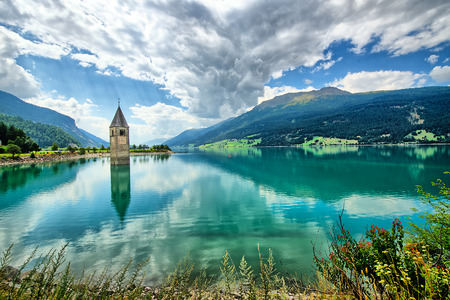 Bell tower of the Reschensee (Resia) South Tyrol Italy Stock Photo