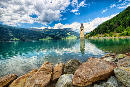 Bell tower of the Reschensee Resia in South Tyrol, Italy