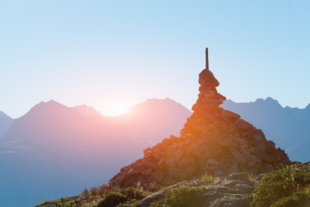 the right path: Mark of the right path in the high mountains Stock Photo