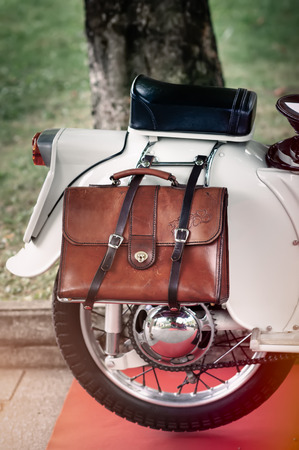 withe: detail on the bag of a withe vintage motorcycle Stock Photo