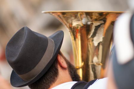 tuba: man plays his tuba during an outdoor party