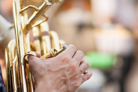 tuba: detail on a girl hand playining tuba Stock Photo