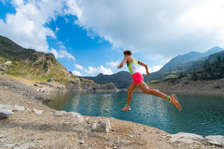 stride: Stride of a woman who trains running near a mountain lake