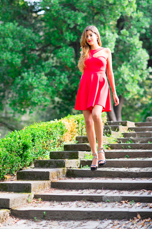 debutante: Girl before the debutante ball down stairs with red dress