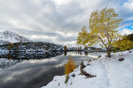 silently: Dam Artificial alpine lake in autumn Stock Photo