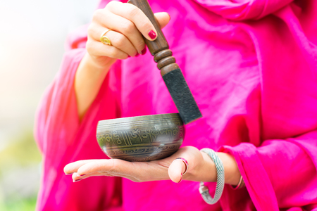 spiritual energy: Tibetan bell in hand and played