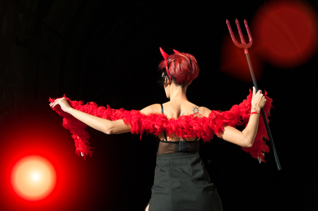 sexy girls: A woman dressed as a devil with horns and pitchfork