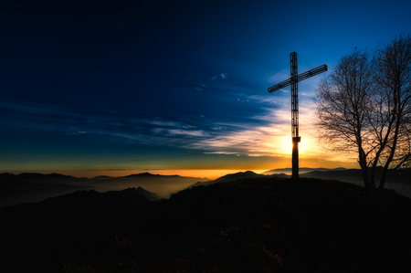spirtual: Summit cross a mountain at sunset religious meditative atmosphere