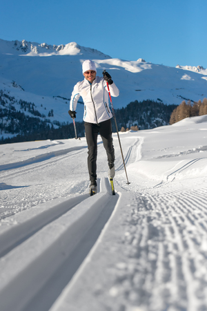 crosscountry: A man cross-country skiing on Tracks