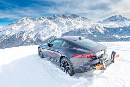 ST. MORITZ. SWITZERLAND 18 February 2016: A sporty car jaguar 4x4 on the slopes exposed to advertising - editorial image