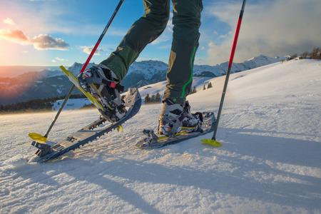 snowshoeing: Closeup hiker in spring mountains snowshoeing