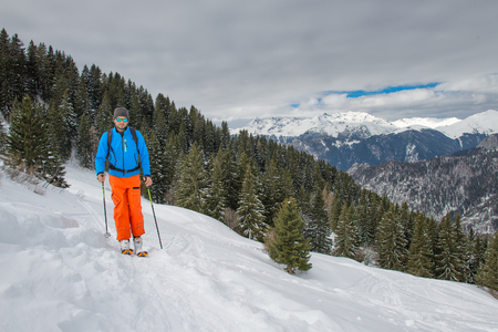 mountaineering: A man alone in the mountains with ski mountaineering Stock Photo