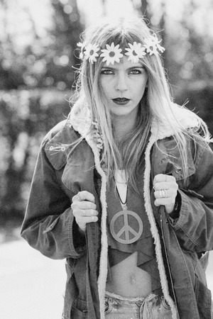 revolutionary: Girl hippie revolutionary in 1970 style  with the symbol of peace and eskimo Stock Photo