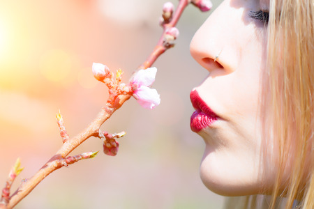 kissing mouth: Girl mouth kissing a flower bud in pring