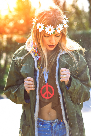 eskimo: Girl hippie revolutionary in 1970 style  with the symbol of peace and eskimo. Picture ruined simulation Stock Photo