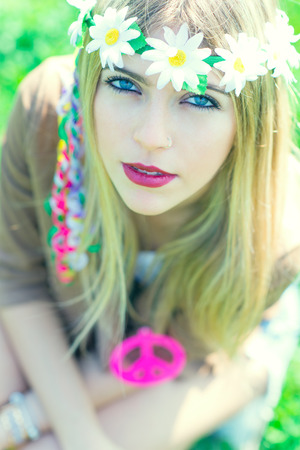 sixties: hippie girl with flower headband and necklace with peace sign