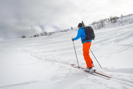 mountaineering: A man practice ski mountaineering alone
