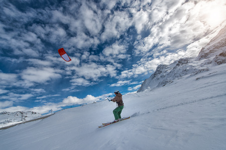 snowkiting: 19 February 2016: St. Moritz  Switzerland. IMan practice snowkiting with skis on the snow