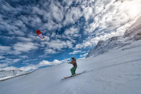 snowkiting: 19 February 2016: St. Moritz  Switzerland. IMan practice snowkiting with skis on the snow