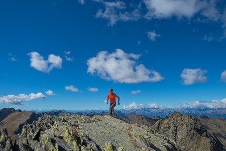 Man practice skyrunning in high mountain alone