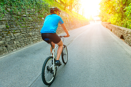 pedaling: Cyclist pedaling uphill lace the mountain road