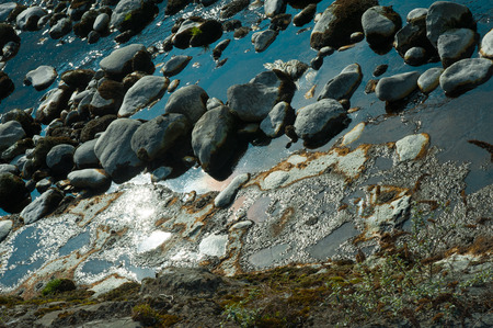 in particular: particular of the stones along the river