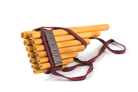 Pan flute Handmade on a white background characteristic hand South America