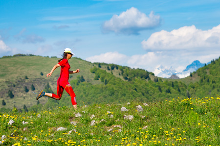 Girl athlete training running in nature in the mountains Stock Photo