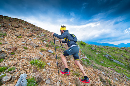 Alpin trail athlete during training towards the top of the mountain Archivio Fotografico