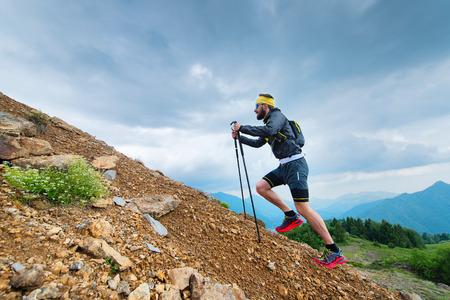 Climb a mountain with Nordic walking sticks