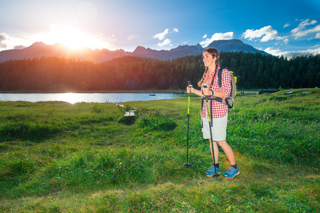 panoramas: Young girl in hike near like mountain in the summer