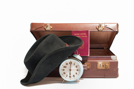reveille: Vintage  suitcase with  italian passport, cap and old  bell