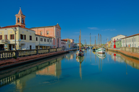 Boats museum in Canal Port in Cesenatico  church and ancient boats on a summer morning Editorial