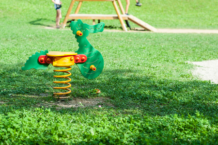 rocking chair: green rocking chair  in a green area for children iin italy