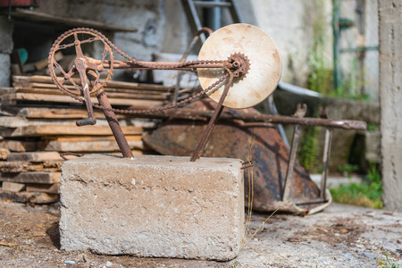 rotates: Stone to polish ancient craft rotates in an old junk shop